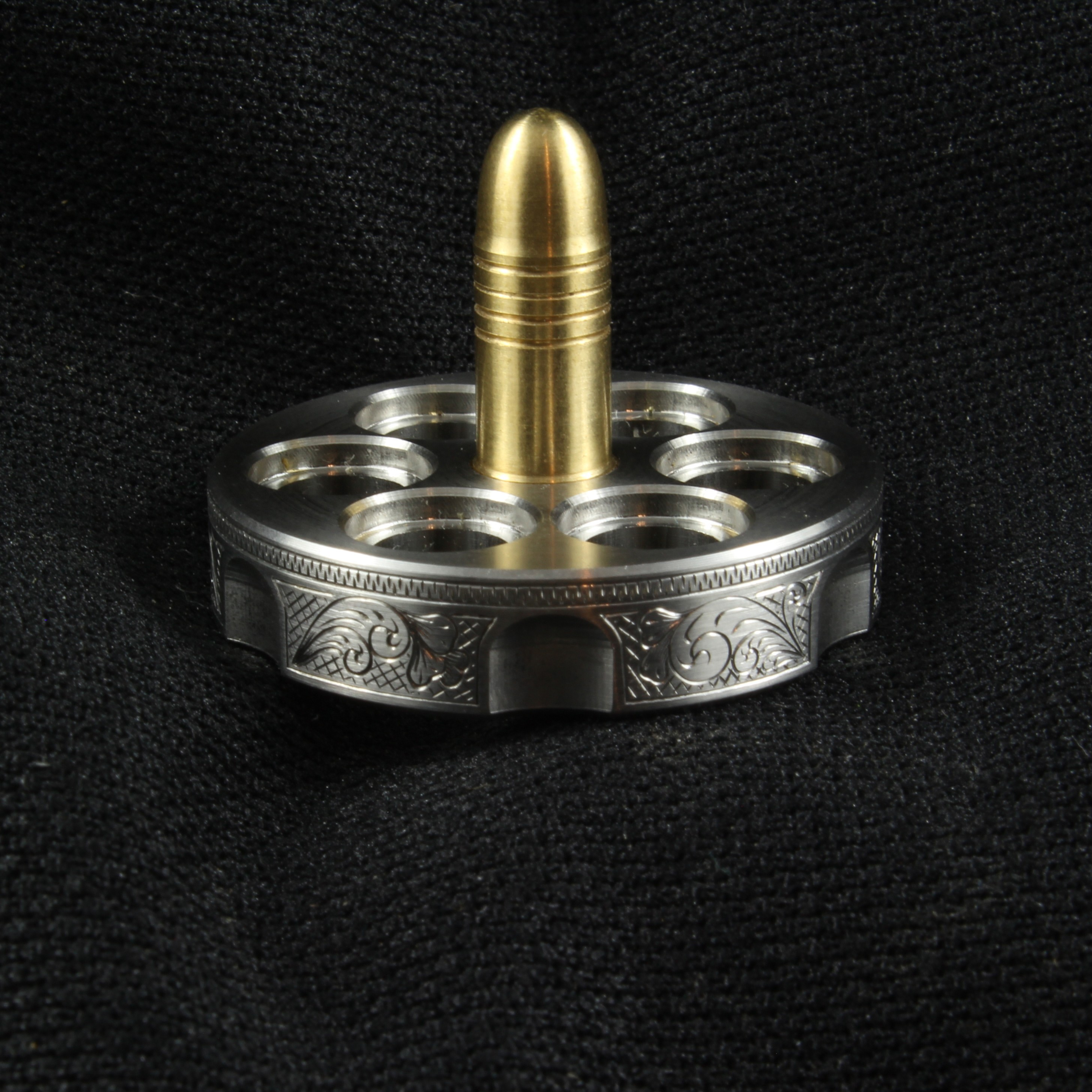 Picture of Revolver spinning top engraved by Glen Funk